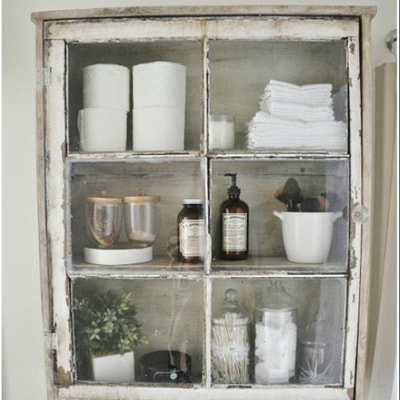 chippy window on wall cabinet