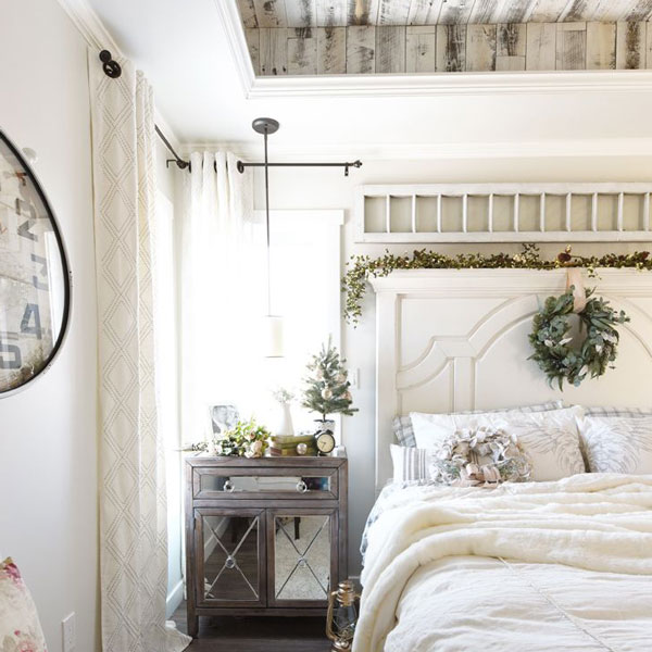 picture of bed with architectural salvage above headboard