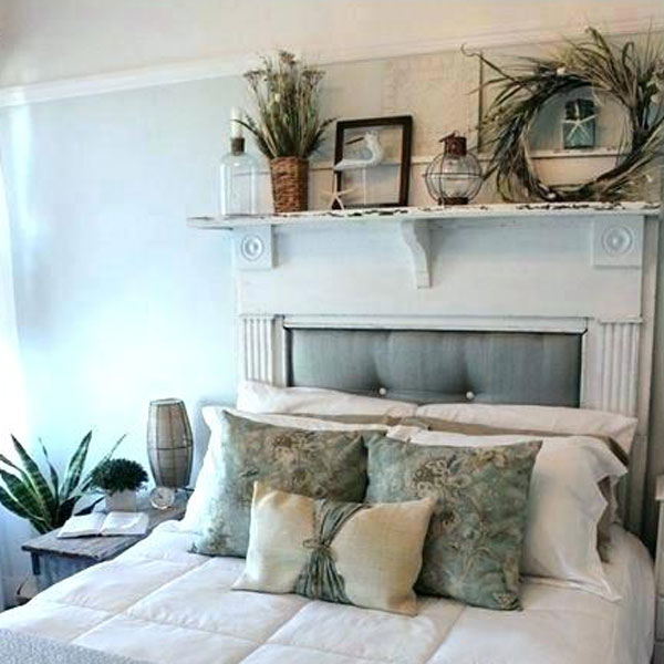 picture of bed with shelf and floral decor hanging above it.