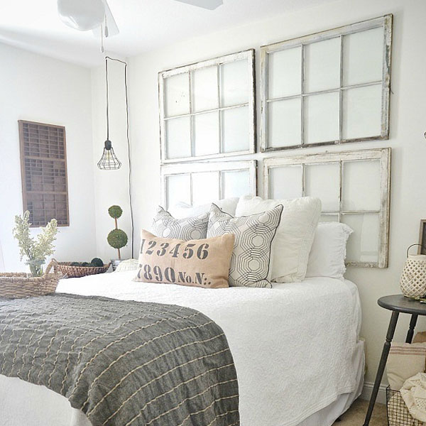 picture of bed with windows used as headboard