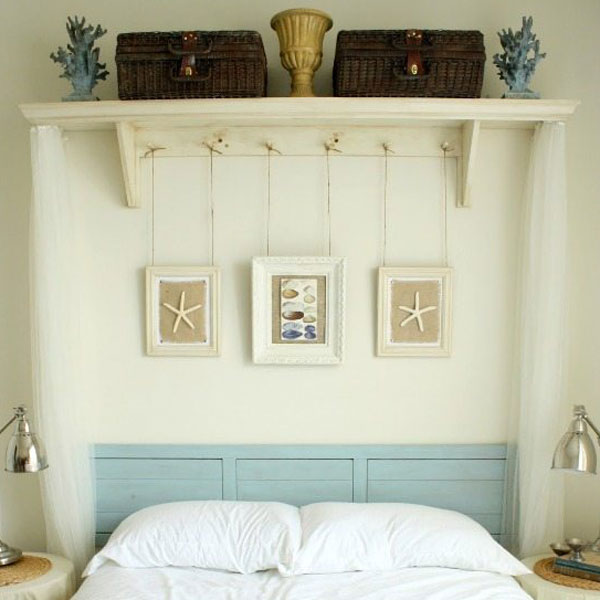 picture of shelf with baskets and prints hanging above it.