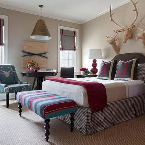 picture of bed with antlers hanging above it.