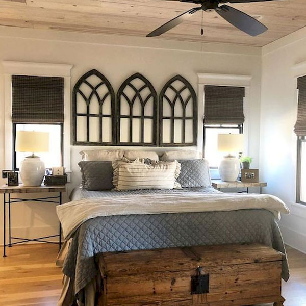 picture of bed with three matching arches hanging above it.