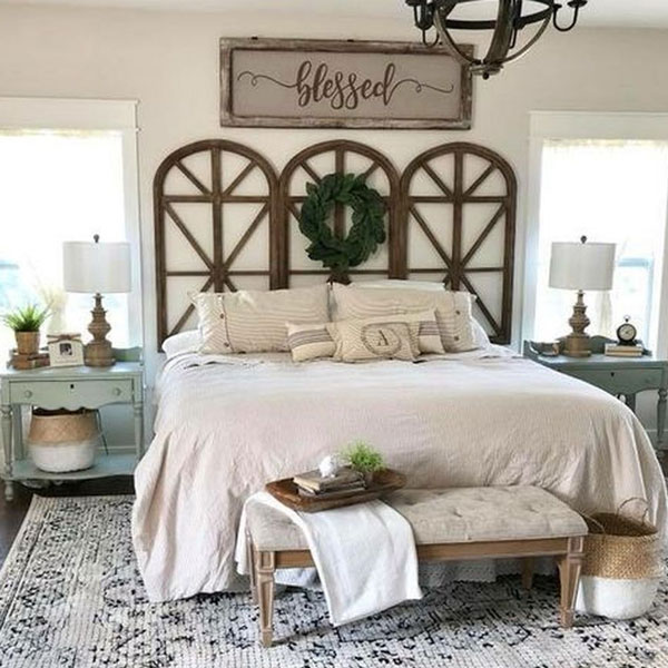 picture of bed with three rounded arches used as headboard.
