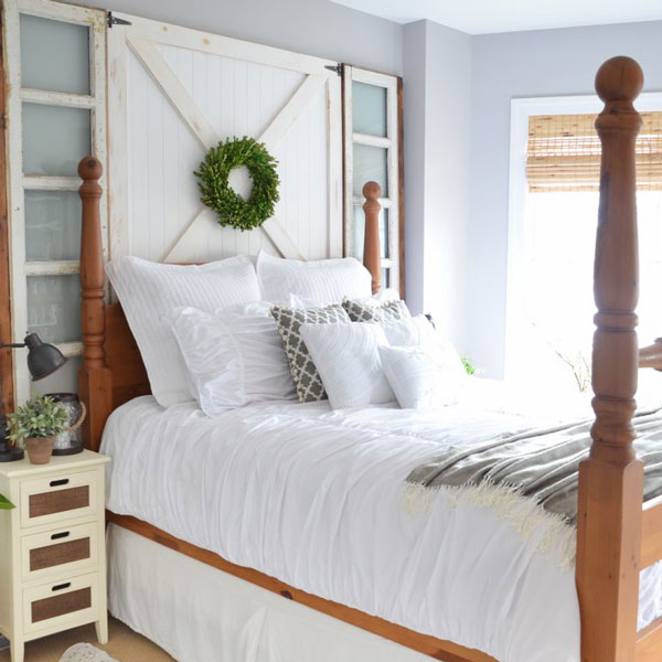 picture of bed with barn door behind