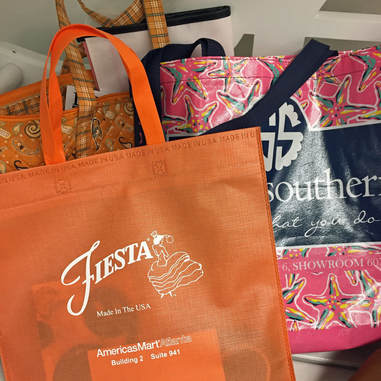 Fiesta and Simply Southern bags of catalogs