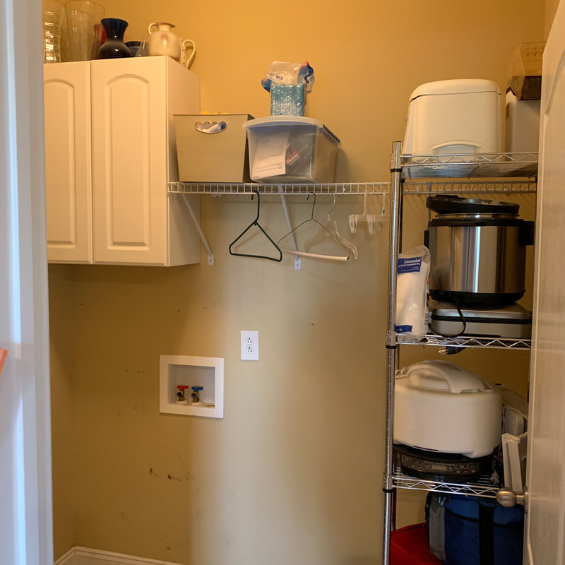 Before picture of a small laundry room during reno